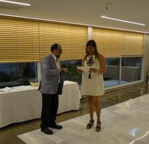 Marianne receiving best poster prize